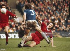 Liverpool player Jimmy Case puts in a hard tackle on Everton full back Mike Pejic during an FA Cup semi final match played at Maine Road on April 23 1977 in Manchester England Liverpool Players, Liverpool Football Club, Liverpool Fc, Jimmy Case, Gerrard Liverpool, Merseyside Derby, Class Games, Manchester England, Everton Fc