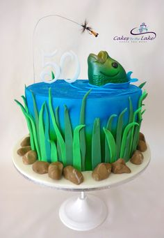 SOMETHING FISHY - FLY FISHING CAKE  Another of our cakes from this week was for a close family member who celebrated her 50th Birthday. Her love of fly fishing is definitely on show here with this red velvet cake covered in fondant and topped with a nice big fondant trout leaping from the water trying to get the 'fly'.  www.cakesbythelake.com.au
