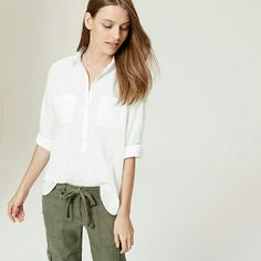 LOFT // Cotton Soft Button Up Meet the softened shirt a light and airy button-down, with no detail left unbuttoned. Summer-perfect, we love how you can endlessly style the tab sleeves of this cotton piece. Point collar. Long sleeves with button tabs. Henley button front. Button cuffs. Back yoke with shirred detail. Shirttail hem. Will add pictures of actual shirt soon. LOFT Tops Button Down Shirts