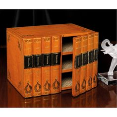 Leather Three-Shelf Desk Organizer. Handmade in Italy of leather over wood, with antique Florentine handtooling. Lined with bookbinder's paper. Magnetic closure. Felt bottom with four leather feet. Easily cleaned with shoe cream. $495
