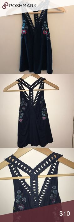 Hollister Racerback Tank ⭐️Navy Blue racerback tank with flower embroidery  ⭐️Great used condition  ⭐️Questions? Just ask! 😊 Hollister Tops Tank Tops