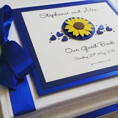 Sunflower wedding guest book,  gorgeous in royal blue  #sunflowers #sunflowerwedding #sunflowerweddingtheme #weddingguestbook #weddingstationery #summerwedding #royalbluewedding www.ohsopurrfect.co.uk www.facebook.com/ohsopurrfect