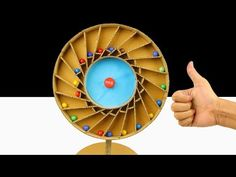 Amazing Diy Racing Spiral Machine With Wheel Marble from cardboard Cardboard Toys, Paper Toys, Hand Juicer, Paper Crafts Origami, Spiral, Projects To Try, Marble, Racing, Homemade