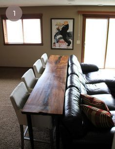 example of bar with stools behind couch. Great for conversation, darts and TV.