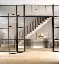 This Gorgeous London Townhouse Embodies Minimalist Swank - Adventures in Interior Design - Curbed National Industrial Kitchen Design, Industrial Door, Industrial Apartment, Industrial Bedroom, Industrial Farmhouse, Vintage Industrial, Industrial Wallpaper, Industrial Bookshelf, Industrial Restaurant