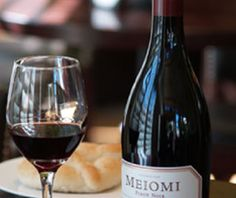 Meiomi Pinot Noir.  Great value at ~ $20.  Extracted, interesting, and un-Pinot like.  Deep magenta color, ripe fruit bouquet, long legs, surprisingly lush, well balanced flavors of black cherry cola, red current, bramble, forest floor bark, and subtle hints of tobacco with round tannins and a smooth vanilla finish.
