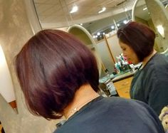 Extreme A-line with mocha red highlights. Hair by Vicki Regis Signature Salon, Flatirons Crossing Mall. Broomfield Co