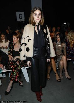 Fashion maven: Olivia Palermo rocked black leather pants as she held court front row at th...