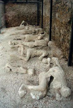 """Garden of the Fugitives"". Plaster casts of victims still in situ; many casts are in the Archaeological Museum of Naples"