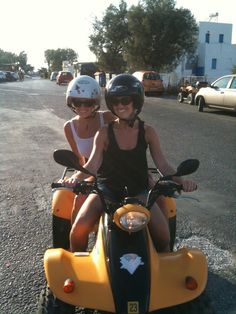 Riding a 4 wheeler across Santorini Island. Best way to see the island - we could pull off the road and go to just about any black sand beach we wanted.