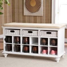 This beautiful, white shoe bench has twelve shoe storage shelves and will accommodate six to twelve pairs of shoes. The bench has a padded seat in warm cream cover that is removable and washable. Thre