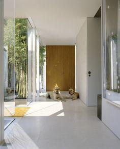 Garden: Corridor Modern Single House Design With White Interior Color Decorating Ideas Ceramic Floor Tiles Plus Wooden And Glass Sliding Doo...