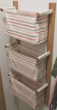 25 Cool DIY Projects And Ideas You Can Do Yourself - Wall hanging storage with 3 IKEA baskets; no instructions on site. Could this be made into a clothes hamper for a small space? Home Crafts, Diy Home Decor, Diy Crafts, Fabric Crafts, Ikea Basket, Wall Basket, Wire Basket Decor, Wall Hanging Storage, Hanging Baskets