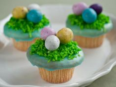 Robin's Egg Easter Basket Cupcakes : Cover your cupcake with candy-covered Easter eggs, perched atop coconut grass, for a playful take on a robin's springtime nest.