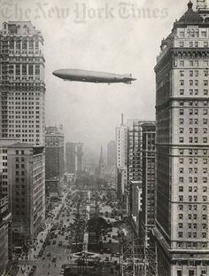 Airship passing over Detroit.  Looking down Washington Blvd.  Book Tower building on left, Book Cadillac Hotel on right. Named for the Book brothers –- Herbert, Frank and J. Burgess Book, Jr.