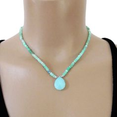Beautiful tiny natural blue green Peruvian Opals with one offset blue green Apatite mingled with tiny handmade fine silver beads surround a beautiful Chalcedony briolette. It closes with a lobster claw clasp and an extender chain with a tiny Turquoise dropping from the end of the extender chain to adorn the back of your neck.  All metal is solid .925-.970 sterling and fine silver.  Peruvian Opal - approx. 4mm Apatite - approx. 4mm Chalcedony - approx. 3/4 long Turquoise - approx. 6mm  Le...