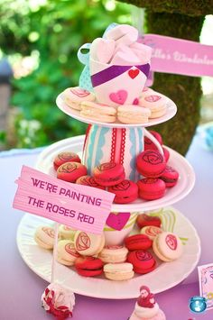 """Paining the roses red"" macarons for an Alice In Wonderland themed shower. Vanilla Bake Shop."