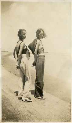 Submitted by Sam. C to The Sartorialist:  'My great-grandmother Nina West (right) and her sister at a beach near a naval base where my great-grandfather was stationed during WWII.' vintage fashions style found photo street beach wear wide leg pants halter tops hats 40s war era