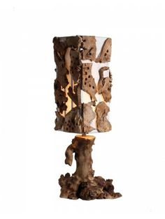 This Rustic desk lamp is made of natural wood root as base. The fabric shade is around with sevral pieces of driftwood as decoration. It is the right lights and décor for your home.