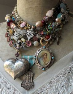 Bonjour, mes amis! This week's jewelry collection is decidedly romantic  with a French flair! Hearts, bows, butterflies, old Catholic medals, and  the most beautiful hand painted portrait mix and mingle with pastel gems  and vintage mother of pearl rosaries to create sweet messages of love.  heavenly heart necklace  bowtied necklace  summer in lyon necklace  giverny necklace  l-o-v-e locket earrings  charms of devotion earrings  unconditional love necklace  Thank you for stopping by! Have…