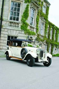 Traditonal English wedding car for the bride - the cream Rolls Royce with black detailing