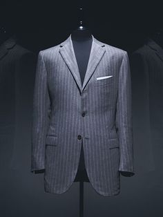 Classic British-tailored suits. Three buttons, fairly narrow lapels, pants that are tapered but not tight.