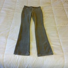 Three pairs, Hue Corduroy pants. Medium. 3 colors. Three pair of Hue thin wale corduroy pants. Pull-on styling. Back pockets are real pockets. Front has faux pockets and faux zipper panel (see photos). Size Medium. Colors are tan, charcoal gray, and expresso brown. Extremely versatile pants. All are good neutral colors. They are perfect for traveling, very easy to pack, and so comfortable and easy to wear. Plus, you will look good in them! Fabric is 54% cotton, 42% polyester 4% spandex on…