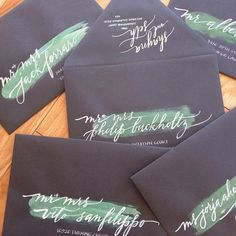 Green Brushstroke White Calligraphy Black Address Envelopes | Anne Robin Calligraphy