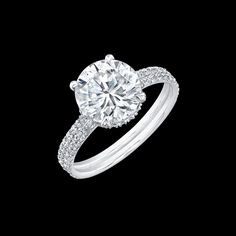 {Love} Round brilliant diamond engagement ring set in a double shank pave platinum setting, by Norman Silverman.