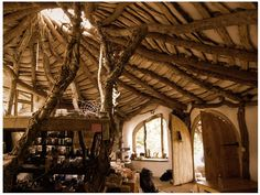 Simon Dale's sustainable hobbit house in Wales. Most natural construction wood based, raw effect and organic lines from the use of natural materials only. Natural light flowing in from the middle of the ceiling. An interior that seems obvious, alive and magical.
