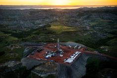 The photo above is an oil drilling rig seen in an aerial view in the early morning hours of July 2013 near Watford City, N. Country Bands, Oil Industry, Alien Worlds, Oil Rig, The Next Big Thing, Watford, New Green, Camping Life, North Dakota