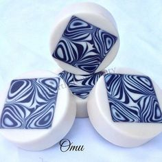 """Omu"" goat milk soap scented with a blend of ginger and bergamot; sounds weird but it smells so good! The centers are embeds made in individual square molds."