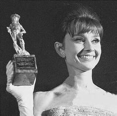 Audrey getting the David di Donatello Award. Taormina, Italy, 25th July 1962.