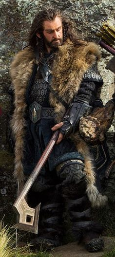 Thorin Oakenshield. The oversized fur mantle calls to mind the Jarls of Viking courts, while the hexagonal lamellar coat provides highly mobile protection, consistent with Thorin's fighting style. The various buckles label him as upper class, while boots and gloves cement him as a true warrior. The blue color scheme is a nice contrast to the browns and greens of the previous films, and ties him to his nephew Kili.