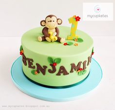 Cheeky monkey 1st birthday cake - Cute cheeky monkey b-day cake for Benjamin.  It's a 7inch chocolate cake and the monkey figurines is inspired by brilliant ' little cottage cupcakes'!     Thanks for watching,xx