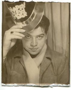 ** Vintage Photo Booth Picture **   Young man tipping his hat to the new year.