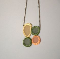 The wonderful 4 white sea glass necklace is crochet of green, yellow, orange viscose yarn and has bronze chain.   The bronze tone chain measures 66 cm (26