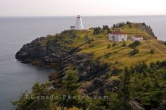 Along the coastline of Grand Manan Island in New Brunswick, Canada, Swallowtail Lighthouse sits upon the landscape overlooking the vast waters of the Bay of Fundy. Top Countries To Visit, New Brunswick Canada, Discover Canada, Lighthouse Photos, Take Better Photos, Canada Travel, Best Hotels, In This World, Traveling By Yourself