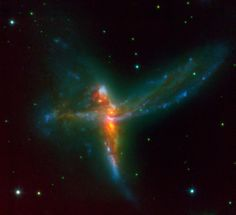 'Cosmic Bird' galaxy, aka ESO 593-IG 008 - It bucks the trend of the more common spiral shaped galaxies, instead appearing as a bird shaped wonder. There is a catch though. What we are seeing is the result of 3 different galaxies crossing paths to form a super galaxy.   It is ~ 650 million light years away & is a part of the luminous infrared galaxies - 1000 billion times luminosity of our sun. Scientists speculate that these kind of galaxies are indicators of a galaxy evolution of sorts.
