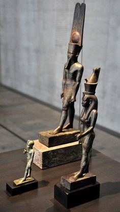 Amun, Mut, and Khonsu (by Osama Shukir Muhammed Amin) -- Three standing-striding divine bronze figures from ancient Egypt. This divine triad represents the god Amun, who wears the feathered crown (behind); Ancient Egypt, Ancient History, Bastet, History Encyclopedia, Cradle Of Civilization, Arte Tribal, Egyptian Art, Egyptian Queen, Anubis