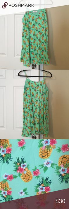 NWOT pineapple print dress Modcloth size S New and never worn. It did not come with tags. It is a size small and is loose and flowy. Fun pineapple print on a green background. I am open to offers! Brand is peach love ModCloth Dresses