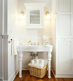 White Cottage bathroom | Free standing porcelain sink with legs, beadboard