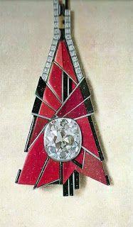 Dusausoy Paris 1925 - platine, diamants, corail, jaspe brun et onyx - le diamant central est de 36carats