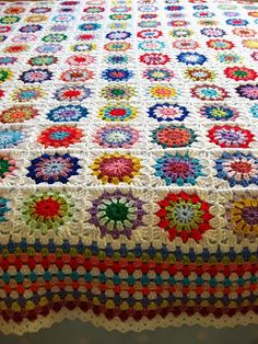 Crocheted squares blanket with granny edging.   Bunny Mummy
