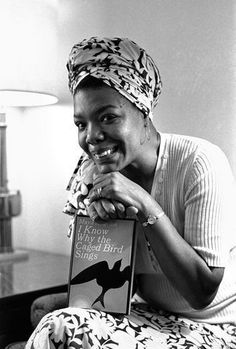 Dr. Maya Angelou with her seminal book I Know Why The Caged Bird Sings