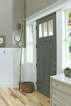 Its just the image but I love the door color and the details. Simple and clean and traditional all at the same time.