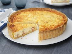 Beautiful creamy quiche with bacon, topped with mozzarella cheese.