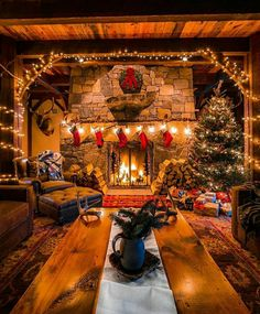 in a Cabin with a warm, cozy fireplace.Christmas in a Cabin with a warm, cozy fireplace. Why do we work so hard to make getting home simple? 🤔 Because it's where we eat together, of course! Cozy Christmas, Country Christmas, Christmas Fireplace, Christmas Stockings, Cabin Christmas Decor, Cottage Christmas, Christmas Decorations For The Home Living Rooms, Christmas Trees, Christmas Lights
