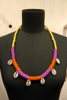 UNITY 2013. Materials; Rayon raffia, acrylic wool, cowrie shells.