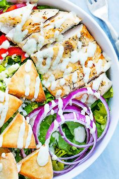 A quick and healthy gyro-inspired salad with crunchy romaine, red onions, and peppers, topped with juicy seasoned chicken , feta cheese, pita croutons, and creamy tzatziki dressing!